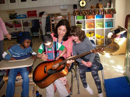 Photo 1- Washington Center Adapted Music Teacher Julie Dail shares guitar fun with students thanks to a Donor's Choose grant.