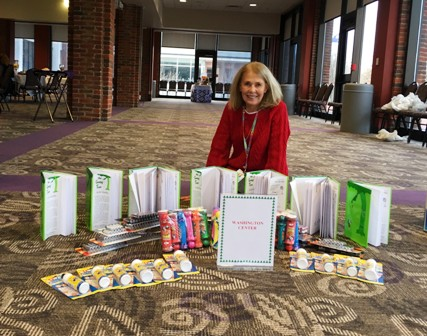 Instructional Coach, Linda Thigpen, accepts gifts from the Furman University Heller Service Corps for the students of Washington Center.