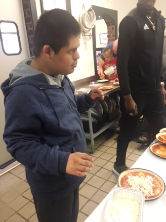 David Chicas and Rodney Blackstone, students in Ms. Piper's Washington Center class, learned how to make pizza at Pizza Inn.