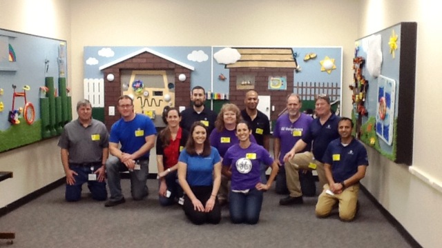 The General Electric Power Supply Chain Team volunteers are pictured with the interactive sensory wall panels that they created for the students of Washington Center.