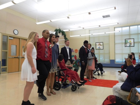 Washington Center Senior Court was presented during the school's annual Valentine's Dance.  Pictured left to right are Washington Center seniors Brandon Palmer, Katie Tollison, Daria Jenkins and Isaiah Henry with their volunteer escorts.