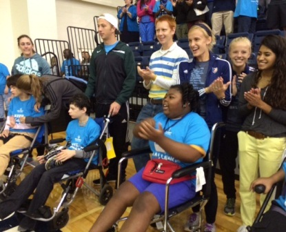Washington Center students (seated left to right) Katie Tollison, Jamie Rodriguez, and Ahnalliyah Wright, along with their student volunteers, celebrate during the opening ceremonies of Special Olympic Challenge Day on the Bob Jones University campus.