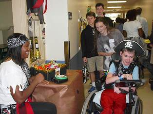 Washington Center student Jesse James is pictured Trick or Treating at teacher Nardia Lloyd's pirate treat station with the assistance of Christ Church Episcopal School volunteer Micah Shutterly during the annual Washington Center Boo in the School event.