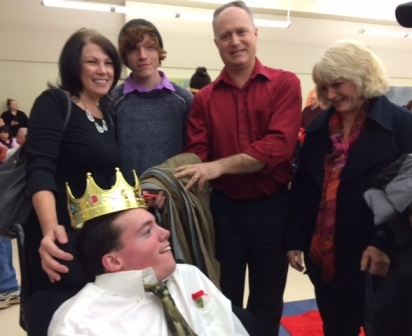 Washington Center Pageant King Davis Dalby is congratulated by his family during the school's annual Valentine Pageant and Dance.